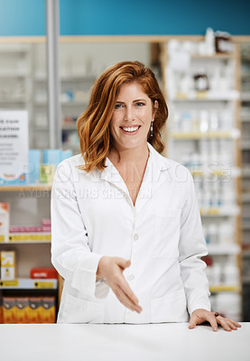 Buy stock photo Portrait of a young pharmacist extending a handshake in a chemist