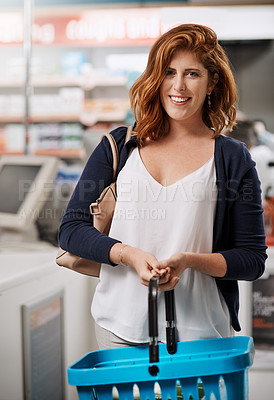 Buy stock photo Portrait of a young woman shopping in a pharmacy
