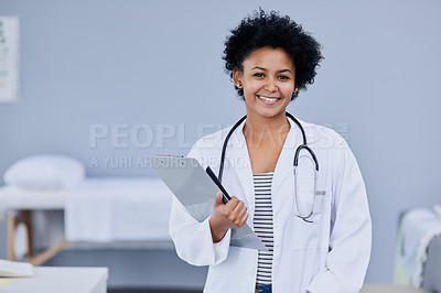 Buy stock photo Cropped shot of a young medical practitioner working in her office