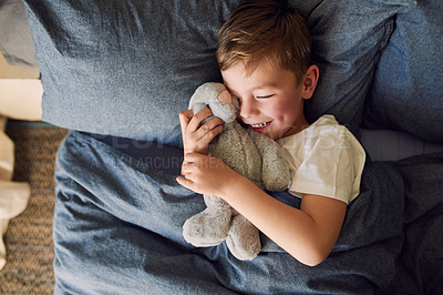Buy stock photo High angle shot of an adorable little boy sleeping in bed at home