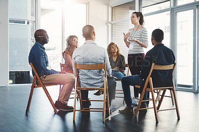 Buy stock photo Shot of a group of diverse creative employees having a meeting inside