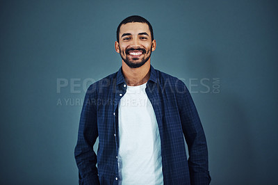 Buy stock photo Studio portrait of a confident man posing against a gray background