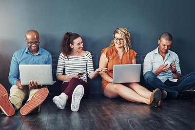 Buy stock photo Studio shot of a diverse group of people social networking against a gray background