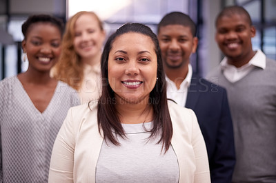 Buy stock photo Portrait of a group of confident businesspeople standing together in a modern office