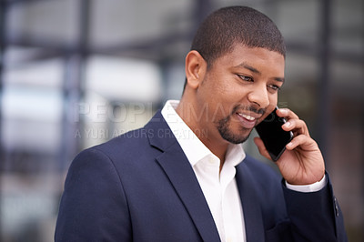 Buy stock photo Shot of a businessman using a mobile phone in a modern office