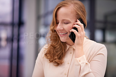 Buy stock photo Shot of a businesswoman using a mobile phone in a modern office