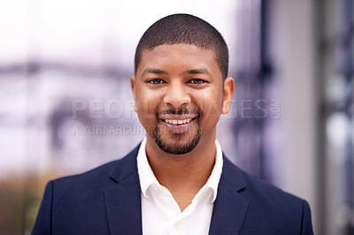 Buy stock photo Portrait of a confident businessman working in a modern office