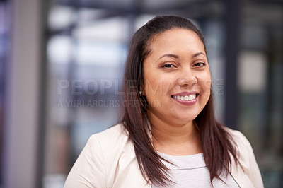 Buy stock photo Portrait of a confident businesswoman working in a modern office