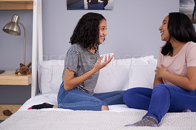Buy stock photo Cropped shot of two teenage girls talking while chilling at home