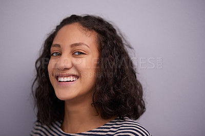 Buy stock photo Studio shot of a teenage girl posing against a purple background