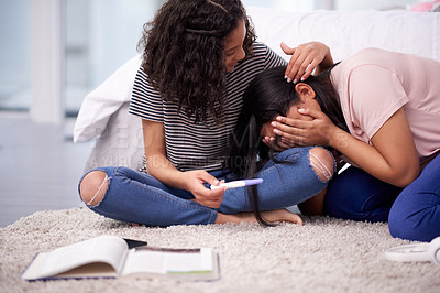 Buy stock photo Shot of a teenage girl crying while her friend comforts her at home