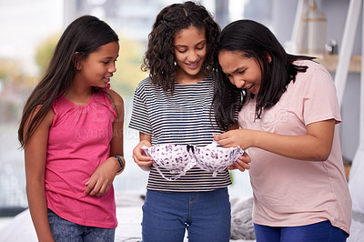 Buy stock photo Cropped shot of three teenage girls talking about a bra at home