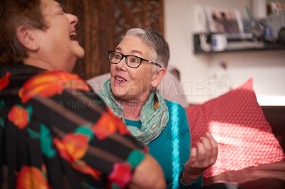 Buy stock photo Shot of two senior women chatting on a sofa