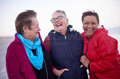 Buy stock photo Shot of a group of senior women enjoying a day at the beach