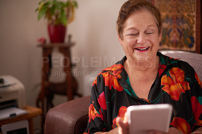 Buy stock photo Shot of a senior woman using a mobile phone at home