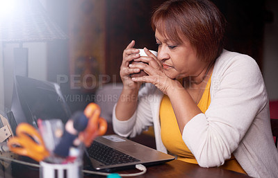 Buy stock photo Shot of a mature woman using a laptop at home