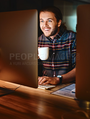 Buy stock photo Shot of a young businessman working late at night in the office