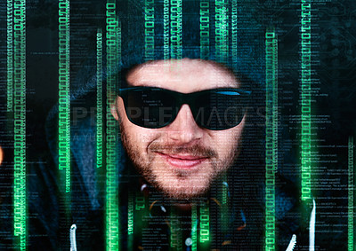 Buy stock photo Portrait of a young male hacker cracking a computer code late at night in the office
