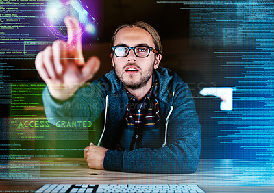 Buy stock photo Cropped shot of a young handsome male programmer working late at night in the office