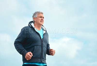Buy stock photo Shot of a mature man exercising outdoors