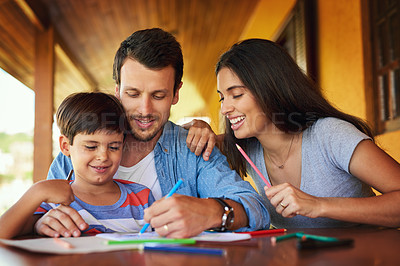 Buy stock photo Shot of a couple and their son coloring in together outdoors