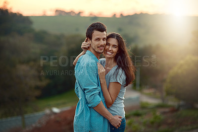 Buy stock photo Cropped portrait of an affectionate young couple sharing a loving moment while standing outdoors