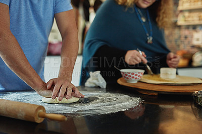 Buy stock photo Cropped shot of an unrecognizable mature couple baking in the kitchen