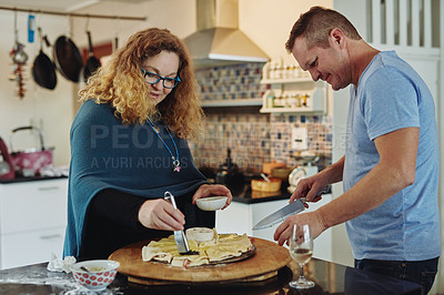 Buy stock photo Cropped shot of an affectionate mature couple cooking in the kitchen