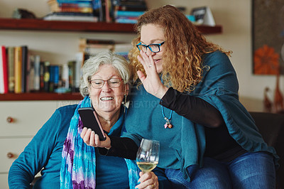 Buy stock photo Cropped shot of a mature woman taking selfies with her senior mother at home