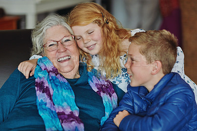 Buy stock photo Cropped portrait of a senior woman sitting on the sofa with her young grandchildren