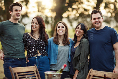 Buy stock photo Shot of a group of friends having fun outdoors over the weekend
