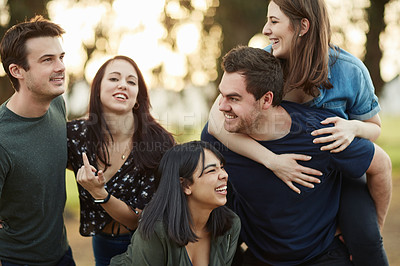 Buy stock photo Cropped shot of a group of friends spending some time together