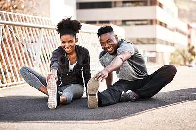 Buy stock photo Full length portrait of a young couple warming up before their workout in the city
