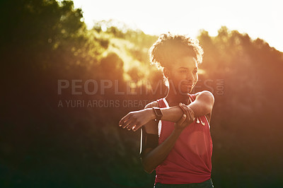 Buy stock photo Cropped shot of an attractive young woman warming up before her workout