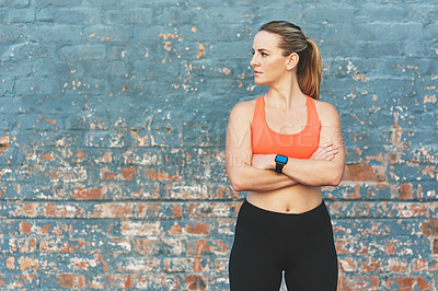 Buy stock photo Cropped shot of a sporty young woman standing outside