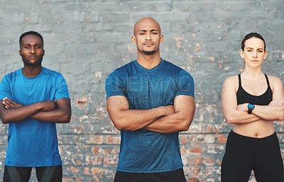 Buy stock photo Cropped shot of three sportspeople standing together