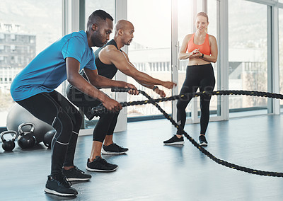 Buy stock photo Shot of people working out in the gym