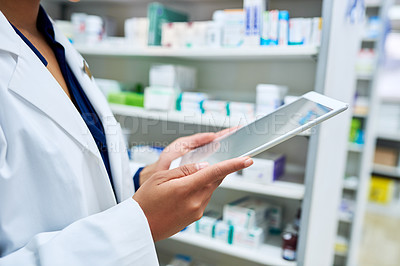 Buy stock photo Cropped shot of an unrecognizable pharmacist using a digital tablet