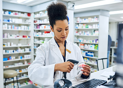 Buy stock photo Cropped shot of a female pharmacist scanning a product