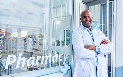 Buy stock photo Shot of a male pharmacist standing in front of his pharmacy