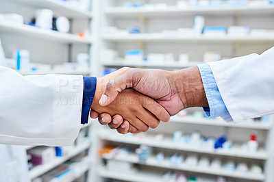 Buy stock photo Shot of pharmacists working in a dispensary