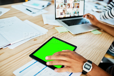 Buy stock photo Cropped shot of a young man using a digital tablet while studying at university
