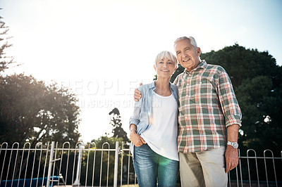 Buy stock photo Portrait of a happy senior couple enjoying a day in the park