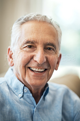 Buy stock photo Cropped portrait of a senior man sitting on the sofa at home