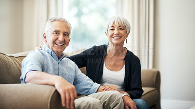 Buy stock photo Cropped portrait of an affectionate senior couple sitting on the sofa at home