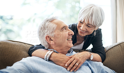 Buy stock photo Cropped shot of an affectionate senior couple in their living room at home