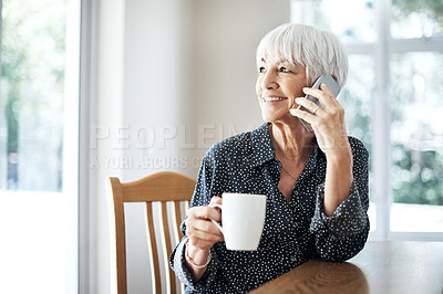 Buy stock photo Cropped shot a senior woman making a phonecall while sitting in her living room at home