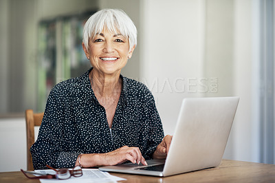 Buy stock photo Cropped portrait of a senior woman going through her finances while sitting at the dining room table