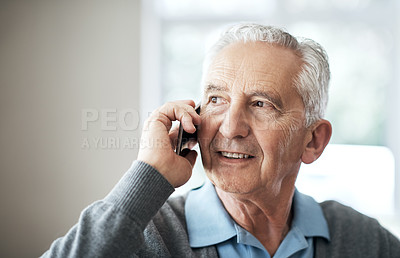 Buy stock photo Cropped shot a senior man making a phonecall while sitting in his living room at home
