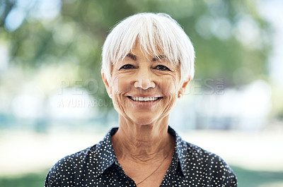 Buy stock photo Cropped portrait of a senior woman standing outside on a summer's day